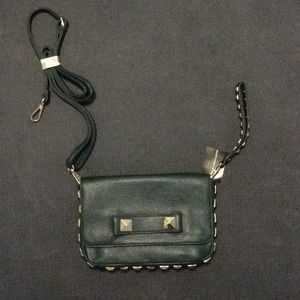 Green purse with gold detail